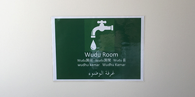 We have posted a sign of Wudu room at the entrance.